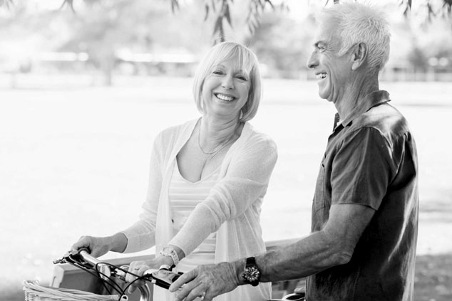 Senior couple riding bikes in a park